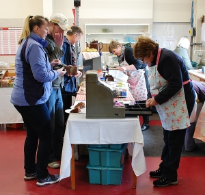 The LVVS has some 200 members, almost half of whom help in preparing for and running our Open Days. The Society is famous for its home-made refreshments, and here on the right you see members of the catering team hard at work in the new café area. Just look at those large helpings of cake!