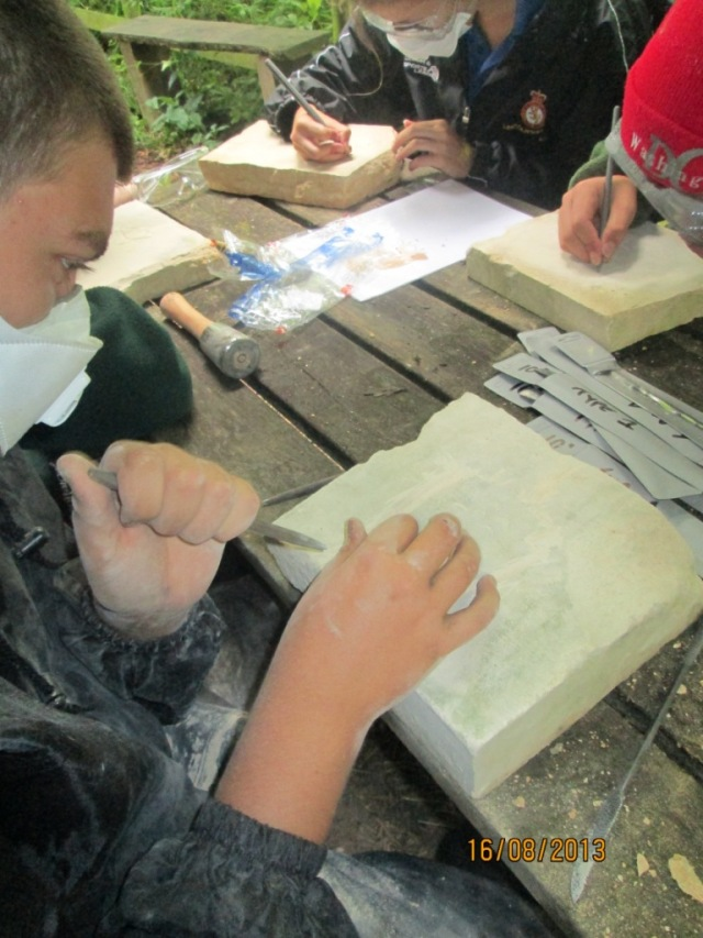 Young people stone carving